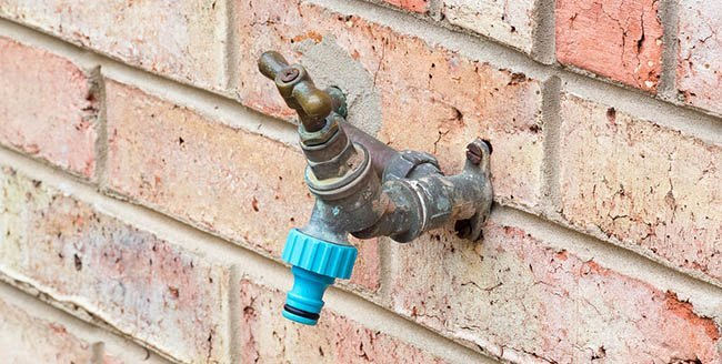 garden tap on the wall